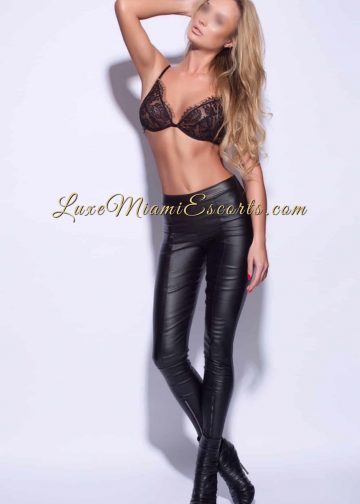 Super hot long hair Miami blonde escort girl Bella in leather pants, sexy boots and black bra