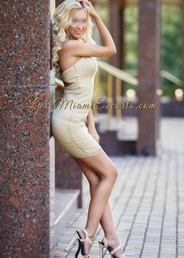 Gorgeous Miami blonde escort Michelle in her elegant beige dress and high heels