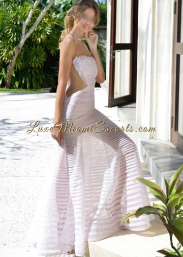 Luxe Miami Escort Renata in her sexy white evening dress entering the luxury house
