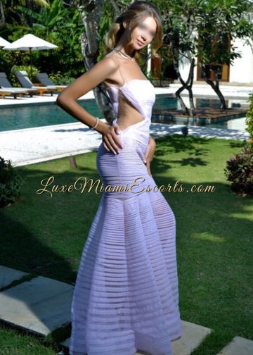 Super hot Miami brunette escort girl posing by the pool in her amazing white evening dress