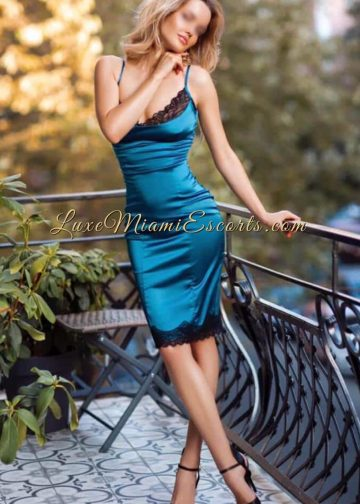Glamorous Miami escort Carina in a blue dress