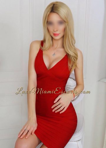 Emma posing in her sexy red dress - a very hot escort in Miami Florida