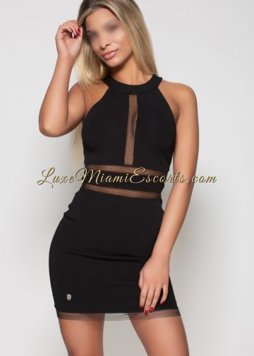 Stunning super hot blonde Miami escort model Helena in her tight short black evening dress