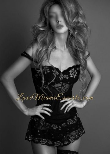 Black and white photo of luxury Miami escorts model Isabella in her sexy lingerie