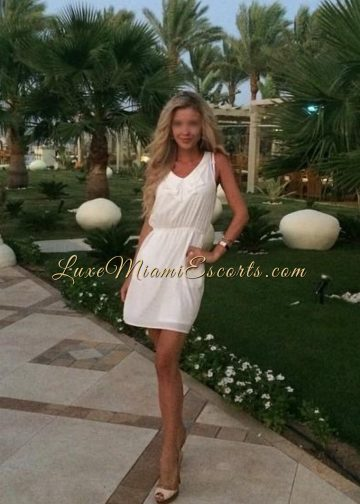 Amateur photo of beautiful Miami blonde escort girl Isabella in her white summer dress