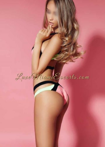 View from the side of super hot dirty blonde Miami escort girl wearing her swimwear