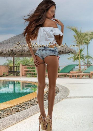 Sexy Miami escort Mia in sexy super short denim shorts and super high heels, showing her gorgeous butt.