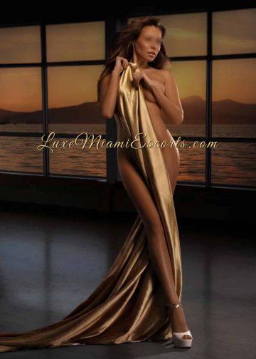 Mia is posing in a studio, amazing Miami female escort model