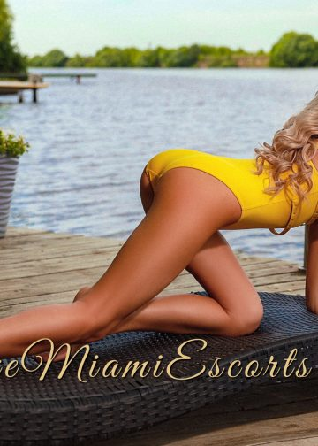 Very hot Miami escort Monica posing in a doggie style by the river