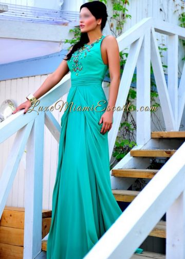 LUXE Miami Escorts model Natally posing in her long greenish evening dress