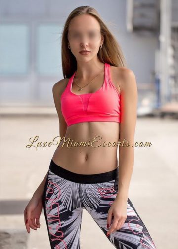 Miami escort Nicole posing in her sexy sport pants and pink bra