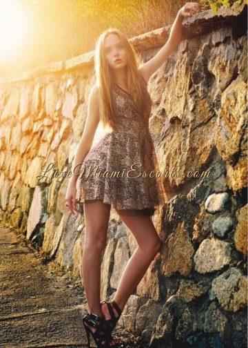 Beautiful Miami escort model Nicole posing in her short dress and high heels
