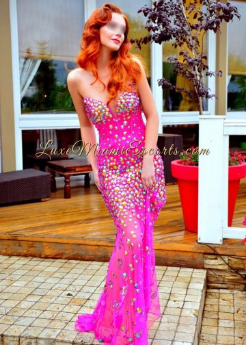 Redhead escorts Miami - Olivia - posing in her pink evening dress