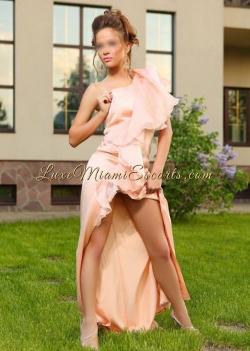 Miami brunette and petite escort model Sofia posing in her long pink evening dress and high heels