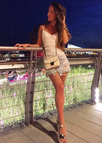 Gorgeous Miami escort girl Veronica posing in her sexy short skirt, white blouse and gold sandals