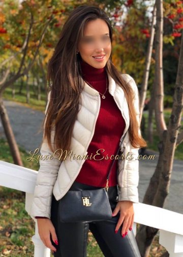 Stunning Miami escort girl Veronica in her leather pants, red sweater and white jacket